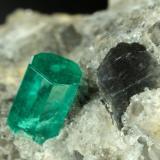 Beryl (variety emerald), Calcite, Dolomite<br />Chivor mining district, Municipio Chivor, Eastern Emerald Belt, Boyacá Department, Colombia<br />22x20x20mm, xl=5mm<br /> (Author: Fiebre Verde)