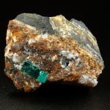 Beryl (variety emerald), Calcite<br />Chivor mining district, Buena Vista Mine, Municipio Ubalá, Eastern Emerald Belt, Cundinamarca Department, Colombia<br />44x55x36mm, xl=13mm<br /> (Author: Fiebre Verde)