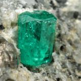 Beryl (variety emerald), Calcite<br />La Pita mining district, Cunas Mine, Municipio Maripí, Western Emerald Belt, Boyacá Department, Colombia<br />27x33x35mm, xl=9mm<br /> (Author: Fiebre Verde)