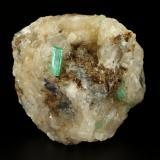 Beryl (variety emerald), Calcite<br />La Pita mining district, Polveros Mine, Municipio Maripí, Western Emerald Belt, Boyacá Department, Colombia<br />67x75x65mm, main xl=14mm<br /> (Author: Fiebre Verde)
