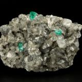Beryl (variety emerald), Calcite, Dolomite<br />La Pita mining district, Municipio Maripí, Western Emerald Belt, Boyacá Department, Colombia<br />81x58x36mm, xls up to 6mm<br /> (Author: Fiebre Verde)