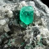 Beryl (variety emerald), Calcite, Dolomite<br />La Pita mining district, Cunas Mine, Municipio Maripí, Western Emerald Belt, Boyacá Department, Colombia<br />56x44x51mm, xls=7mm & 4mm<br /> (Author: Fiebre Verde)