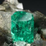 Beryl (variety emerald), Calcite, Dolomite<br />La Pita mining district, Municipio Maripí, Western Emerald Belt, Boyacá Department, Colombia<br />37x24x31mm, xl=24mm<br /> (Author: Fiebre Verde)
