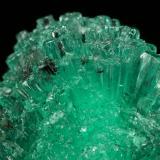 Beryl (variety emerald), Calcite<br />Coscuez mining district, Municipio San Pablo de Borbur, Western Emerald Belt, Boyacá Department, Colombia<br />24mm across<br /> (Author: Fiebre Verde)
