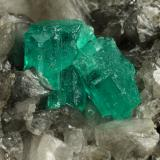 Beryl (variety emerald), Calcite, Dolomite<br />Muzo mining district, Western Emerald Belt, Boyacá Department, Colombia<br />79x49x66mm, largest xl=13x9mm<br /> (Author: Fiebre Verde)