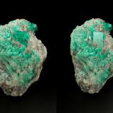 Beryl (variety emerald), Calcite, Muscovite<br />La Pita mining district, Cunas Mine, Municipio Maripí, Western Emerald Belt, Boyacá Department, Colombia<br />40x63x47mm, largest xl=14x11mm<br /> (Author: Fiebre Verde)