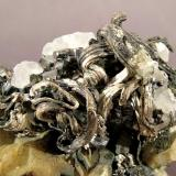 Silver with Stephanite on Calcite<br />Freiberg District, Erzgebirgskreis, Saxony/Sachsen, Germany<br />Specimen size: 6.8 × 5 × 3 cm<br /> (Author: Jordi Fabre)