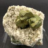 Chalcopyrite on Quartz<br />Tincroft Mine, Carn Brea and Tincroft United Mines, Carn Brea, Camborne - Redruth - Saint Day District, Cornwall, England, United Kingdom<br />Specimen size: 3.7 × 3.4 × 3.1 cm<br /> (Author: Jordi Fabre)