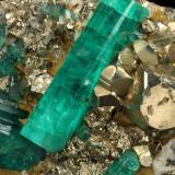 Beryl (variety emerald), Albite (variety cleavelandite), Pyrite<br />Chivor mining district, El Oriente Mine, Municipio Chivor, Eastern Emerald Belt, Boyacá Department, Colombia<br />110x54x20mm, largest xl=30mm<br /> (Author: Fiebre Verde)