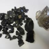 Quartz and anthraxolite<br />Turtle Clan Ridge, Fonda, Mohawk, Montgomery County, New York, USA<br />Quartz is 10cm.<br /> (Author: vic rzonca)