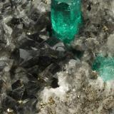 Beryl (variety emerald), Calcite, Dolomite, Pyrite<br />Chivor mining district, El Acuario Mine, Municipio Chivor, Eastern Emerald Belt, Boyacá Department, Colombia<br />84x43x54mm, xl=7mm<br /> (Author: Fiebre Verde)