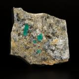 Beryl (variety emerald), Albite (variety cleavelandite), Calcite, Dolomite, Pyrite<br />Chivor mining district, Municipio Chivor, Eastern Emerald Belt, Boyacá Department, Colombia<br />72x71x23mm, xl=14mm<br /> (Author: Fiebre Verde)