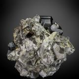Cassiterite and Scheelite on Quartz<br />Taoxikeng Mine, Chongyi, Ganzhou Prefecture, Jiangxi Province, China<br />70 X 62 mm<br /> (Author: Manuel Mesa)