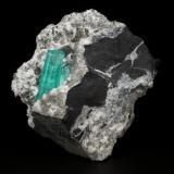 Beryl (variety emerald), Albite (variety cleavelandite), Calcite, Pyrite<br />Chivor mining district, Palo Arañado Mine, Municipio Chivor, Eastern Emerald Belt, Boyacá Department, Colombia<br />55x56x22mm, main aggregate=24mm<br /> (Author: Fiebre Verde)