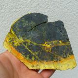"Uraninite (variety ""pitchblende"") with ""gummites"" and Curite (?)Mina Margnac II, Compreignac, Haute-Vienne, Nouvelle-Aquitaine, Francia10 x 9 cm (Author: Benj)"