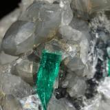 Beryl (variety emerald), Calcite, Dolomite<br />La Pita mining district, Cunas Mine, Municipio Maripí, Western Emerald Belt, Boyacá Department, Colombia<br />47x45x47mm, xl=18mm - 2 xls in the back: 11mm & 7mm<br /> (Author: Fiebre Verde)