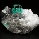 Beryl (variety emerald), Calcite, Pyrite, Quartz<br />Muzo mining district, Western Emerald Belt, Boyacá Department, Colombia<br />32x21x20mm, xls=7mm (main) & 17mm<br /> (Author: Fiebre Verde)