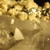 Apatite and Pyrite on Quartz<br />Minas da Panasqueira, Aldeia de São Francisco de Assis, Covilhã, Castelo Branco, Cova da Beira, Centro, Portugal<br />FOV 11 mm<br /> (Author: franjungle)