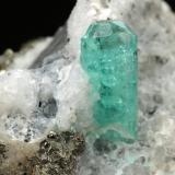 Beryl (variety emerald), Calcite, Pyrite<br />Chivor mining district, Municipio Chivor, Eastern Emerald Belt, Boyacá Department, Colombia<br />30x28x17mm, xl=10mm<br /> (Author: Fiebre Verde)