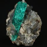 Beryl (variety emerald), Calcite, Pyrite<br />Chivor mining district, Municipio Chivor, Eastern Emerald Belt, Boyacá Department, Colombia<br />20x20x13mm, xl=20mm<br /> (Author: Fiebre Verde)