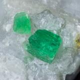 Beryl (variety emerald), Calcite<br />La Pita mining district, Municipio Maripí, Western Emerald Belt, Boyacá Department, Colombia<br />52mm x 46mm x 22mm<br /> (Author: Bergur_E_Sigurdarson)