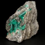 Beryl (variety emerald), Calcite, Pyrite<br />La Pita mining district, Municipio Maripí, Western Emerald Belt, Boyacá Department, Colombia<br />59x40x41mm, largest xl=20mm<br /> (Author: Fiebre Verde)