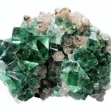 Fluorite, Quartz<br />Okorusu Mine, Otjiwarongo District, Otjozondjupa Region, Namibia<br />Specimen size 15 cm, largest fluorite 2,5 cm<br /> (Author: Tobi)