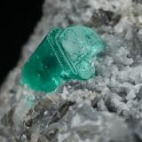 Beryl (variety emerald), Calcite<br />Muzo mining district, Western Emerald Belt, Boyacá Department, Colombia<br />37x19x24mm, xl=9x6mm<br /> (Author: Fiebre Verde)