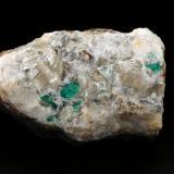 Beryl (variety emerald), Calcite, Quartz, Fluorite<br />Peñas Blancas Mine, Municipio San Pablo de Borbur, Western Emerald Belt, Boyacá Department, Colombia<br />100x61x65mm, main xls=7 & 7mm<br /> (Author: Fiebre Verde)
