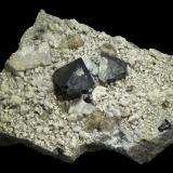 Magnetite<br />Huayriquiña mine (Huaraniquiña mine), Cerro Huañaquino, Paco Grande, Tomás Frías Province, Potosí Department, Bolivia<br />45 x 30 x 21 mm<br /> (Author: Rob Schnerr)