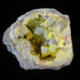 Azufre<br />Afloramiento El Aila, El Aila (La Lastra), Laredo, Cantabria, España<br />Pieza de 8.5x6.6cm y cristales de hasta 3cm.<br /> (Autor: DAni)