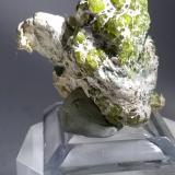 Andradite (variety demantoid), asbestos<br />Sferlùn asbestos Mine, Vallone del Cengiaccio, Lanzada, Malenco Valley (Valmalenco), Sondrio Province, Lombardy, Italy<br />33 x 32 mm<br /> (Author: Sante Celiberti)