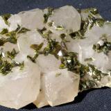 Epidote on quartz<br />Meigu, Liangshan Autonomous Prefecture, Sichuan Province, China<br />6 x 4 cm<br /> (Author: Volkmar Stingl)