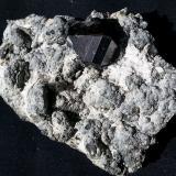 Cassiterite, Laumontite<br />Amo deposit, Ximeng, Pu'er Prefecture, Yunnan Province, China<br />7 x 5 cm<br /> (Author: Volkmar Stingl)