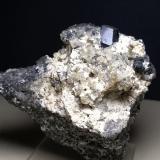 Andradite (variety melanite), Sanidine<br />Case Collina (Toscopomici Quarry), Pitigliano, Grosseto Province, Tuscany, Italy<br />55 x 50 mm<br /> (Author: Sante Celiberti)