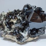 Cassiterite and Quartz<br />Amo deposit, Ximeng, Pu'er Prefecture, Yunnan Province, China<br />Specimen size: 11.8 × 9.7 × 7.5 cm / main crystal size: 4.7 × 4.7 cm<br /> (Author: Jordi Fabre)