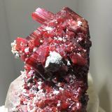 Realgar on Calcite<br />Jiepaiyu Mine (Shimen Mine), Shimen County, Changde Prefecture, Hunan, China<br />4 cm crystal<br /> (Author: Jean Suffert)