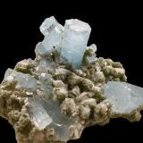 Beryl (variety aquamarine) on Muscovite and Albite<br />Nagar, Hunza Valley, Nagar District, Gilgit-Baltistan (Northern Areas), Pakistan<br />13 X 10 cm, biggest crystal 4.5 cm<br /> (Author: Jean Suffert)