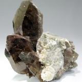 Axinite, calcite Puiva Mount, Saranpaul, Prepolar Ural, Tyumenskaya Oblast', Urals Region, Russia 37 mm × 32 mm (Author: Carles Millan)