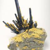 Stibnite, Baryte, calcite Dahegou Mine, Lushi, Sanmenxia, Henan, China Main stibnite crystal size: 90 mm x 10 mm (Author: Carles Millan)
