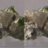 Olivine series, Forsterite var.Peridot with Calcite; Sapat Gali (Soppat), Kohistan, Pakistan. 50x35x33mm, 56g. GN's collection id 09PKOcm01. Taken in direct sunlight. Stereo pair. (Author: Gerhard Niklasch)