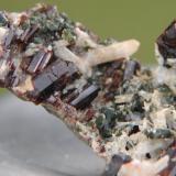Vesuvianite, Scapolite, Diopside in Calcite matrix. Ais-Dome, Otjihorongo, Omaruru District, Namibia. 7.6cm x 4cm x 3.5cm (Author: Debbie Woolf)