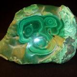 "My first Malachite. I have to agree with Jordi on the sacredness of leaving a mineral in its natural form. This is not what I had ordered, the dealer was helping. Still it has the habit I am most enamored with, and kids think its pretty. It is 5"" x 3 1/2 x 2"" (12.7cm x 8.9cm x 5.1cm) (Author: Jim Prentiss)"