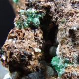 Annabergite, Dolomite and Siderite KM3 Mine Laurion Greece. FOV 12 x 8 mm (Author: nurbo)