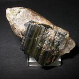 3 cm wolframite plate on smoky quarz crystal from Zinnwald, Erzgebirge, Saxony. (Author: Andreas Gerstenberg)