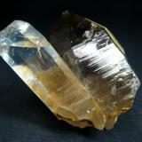 Topaz crystal, that sitting on smoky quartz - classical specimen from Groot Spitzkoppe, Swakopmund District, Erongo Region, Namibia  Size 60 x 50 x 45 mm (Author: olelukoe)