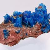 Blue chalcanthite on a matrix, from Planet Mine, La Paz, Arizona, United States Of America. It weighs 98,4 grams and measures 104mm by 55mm by 32mm. (Author: Paul S)