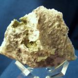 """This specimen is Forsterite, tiny pale green druzy crystals lining small vugs in matrix. I picked it up in 1995 near New Chenega Village, Evans Island, Prince William Sound, Alaska. the piece is 1 3/8"""" x 1 3/8"""" (3.49cm x 3.49cm) (Author: Jim Prentiss)"""