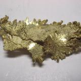 Oro, mina Round Mountain, Nye Co., Nevada, USA, 3,9x1,9x0,7 cm. (Autor: Edelmin)