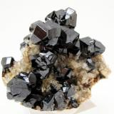 Cassiterite, quartz Viloco Mine (Araca mine), Loayza Province, La Paz Department, Bolivia 83 mm x 72 mm x 49 mm. Main cassiterite crystal: 17 mm tall, 16 mm wide (Author: Carles Millan)